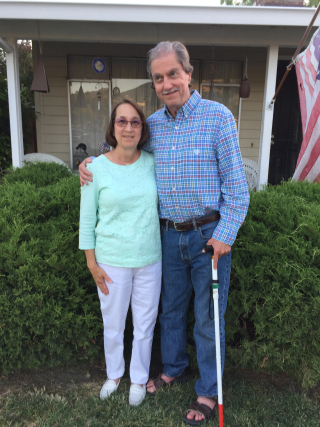 Bill and Kathy June 2017 standing in front yard